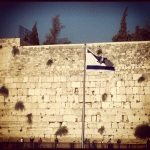 The Israeli flag flying in front of the Wailing Wall
