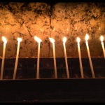 Candles lit around the supposed tomb of Jesus in the Church of the Holy Seplecher